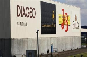 A man walks past a building in the Diageo Shieldhall facility near Glasgow, Scotland